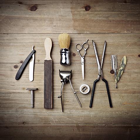 Vintage equipment of barber shop on wood background